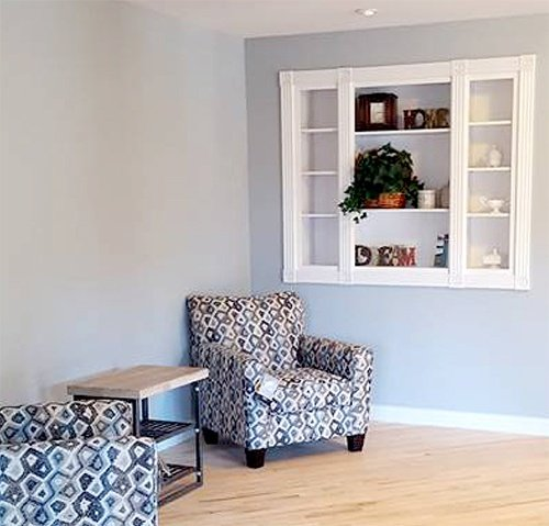 Common space with two chairs and decor nook